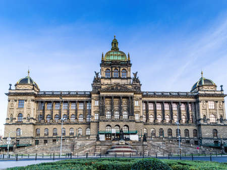 Buildings  and houses in the historical center of Prague. Wenceslas square in Prague in Central Europe: the equestrian statue of Saint Wenceslas and the Neorenaissance National Museum 스톡 콘텐츠