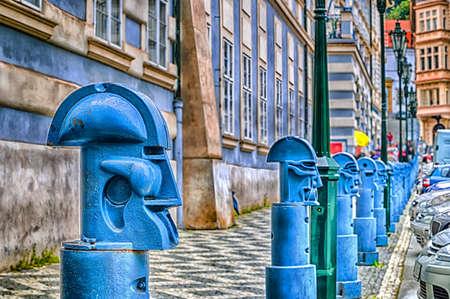 The light blue metal Cubist Bollards in Malostranske namesti (Little Quarter Square) in Prague