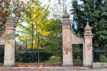 Gate of the garden of a church in the village of  Belricetto near Ravenna in the countryside of Emilia Romagna in Northern Italy photo