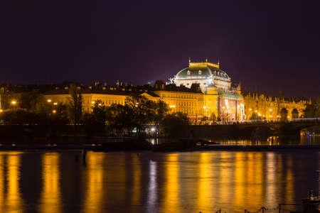 vltava: National theatre at night in Prague on the Vltava river