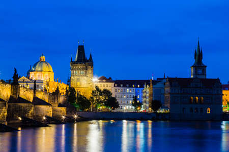 A night view of the river Vltava and Karlovy Most, the Charles Bridge in Prague photo