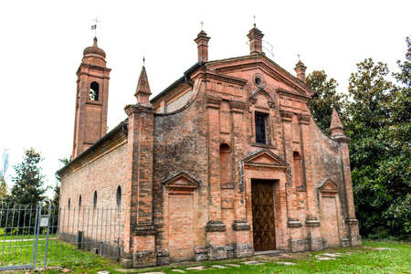 ravenna: Brickwall facade of a XVII century , church dedicated to Our Lady of Conception in the village of  Belricetto near Ravenna in the countryside of Emilia Romagna in Northern Italy: its building began in 1686