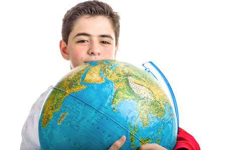 eyes hidden: A Caucasian boy hidden a globe reveals only the eyes and part of the face