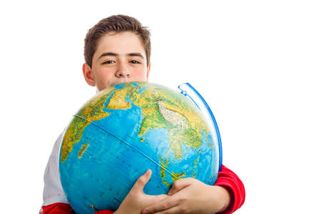 eyes hidden: A Caucasian boy hugs a globe revealing only the eyes and part of the face