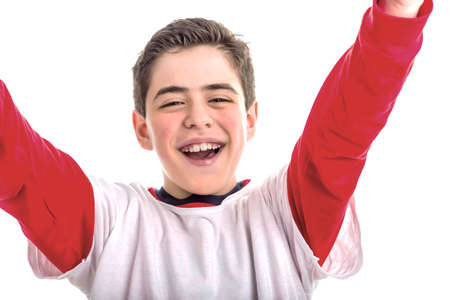 outstretching: A cute Caucasian boy offers a hug outstretching arms to viewer. He wears white shirt with red long sleeves Stock Photo
