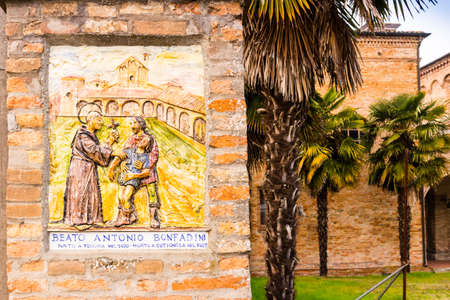 exorcism: The fresco represents the meeting of the Catholic Blessed with a man and his suffering son, probably  during an exorcism: it's at the entry of the garden of the XV century roman gothic church dedicated to Saint Francis in Cotignola in Italy