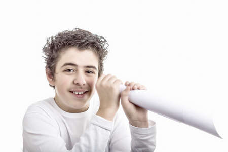 fake smile: Cute smiling hispanic boy is going to look in a fake spyglass made of white paper