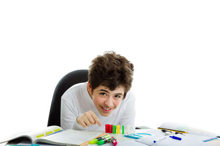 white long sleeve: Smiling Caucasian boy wearing a white long sleeve t-shirt is playing with dominoes on homework Stock Photo