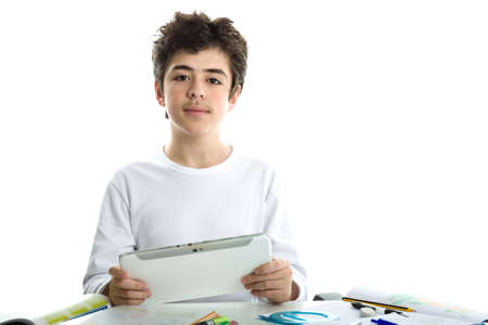 long sleeve: Calm and confident Caucasian smooth-skinned boy wearing a white long sleeve t-shirt is holding a tablet computer on homework