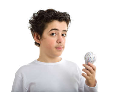 long sleeved: Puzzled Caucasian smooth-skinned boy in white long sleeved t-shirt holding 3D printed lightbulb Stock Photo