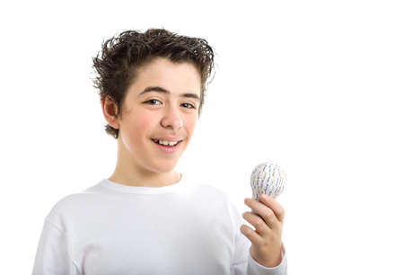 long sleeved: Happy Caucasian smooth-skinned boy in white long sleeved t-shirt smiles holding 3D printed lightbulb with left hand