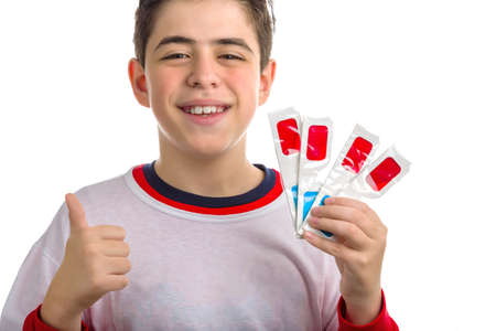 red skinned: Caucasian smooth-skinned boy holds four 3D Cinema paper eyeglasses with red and sky-blue lenses with left hand while making success sign with right hand