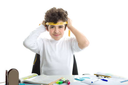 Before doing homework, handsome Caucasian smooth-skinned boy is smiling and tying around the forehead a yellow measure tape in a similar way as Japanese suicide bombers did during World War. blank icon in the foreground photo