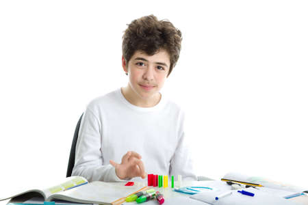 white long sleeve: Smiling Caucasian smooth-skinned boy wearing a white long sleeve t-shirt is playing with dominoes on homework