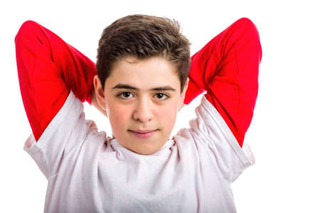 red skinned: Caucasian smooth-skinned boy is stretching raising folded arms and looking calm and confident