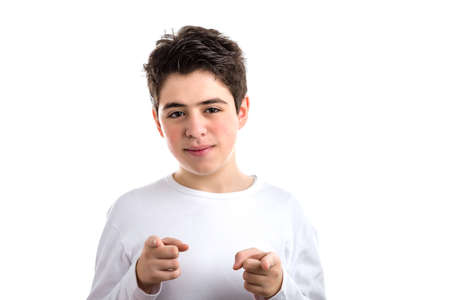 white long sleeve: Caucasian smooth-skinned kid in a white long sleeve t-shirt smiles double pointing with both  index fingers