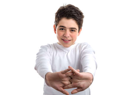 long sleeve: Tired Caucasian smooth-skinned boy in a white long sleeve t-shirt stretching his back with clasped hands