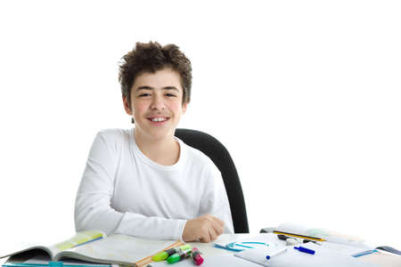 elbow white sleeve: Calm and confident Caucasian smooth-skinned boy wearing a white long sleeve t-shirt smiles while his right elbow is resting on homework