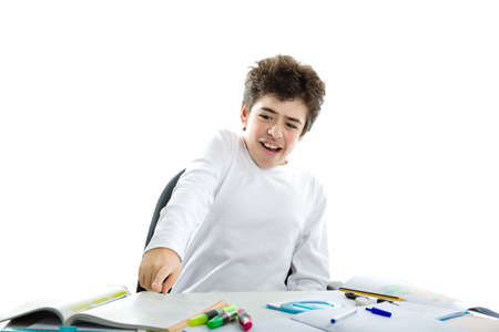panicky: Panicky Caucasian smooth-skinned boy wearing a white long sleeve t-shirt is pointing to homework Stock Photo