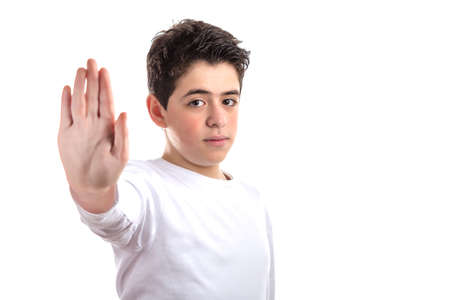 dislike it: smooth-skinned Caucasian teen skin in a white long sleeve t-shirt dislikes making Talk to the hand gesture with right hand Stock Photo