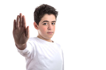dislike it: smooth-skinned  Caucasian teen in a white long sleeve t-shirt smiles making Talk to the hand gesture with right hand Stock Photo