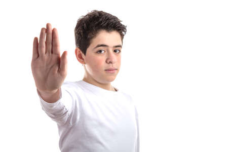 dislike it: Caucasian smooth-skinned teen in a white long sleeve t-shirt making Talk to the hand gesture with right hand