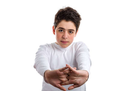 hairy back: Tired Hispanic boy with acne skin in a white long sleeve t-shirt stretching his back with clasped hands Stock Photo