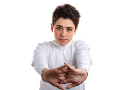 long sleeve: Tired Hispanic boy with acne skin in a white long sleeve t-shirt stretching his back with clasped hands Stock Photo