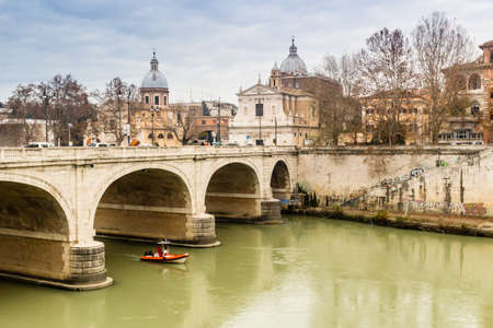 tevere: Bridge over the Tiber river in the center of Rome. Basilica of St. Peter in the background