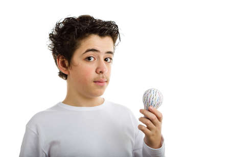 sleeved: Puzzled hispanic boy in white long sleeved t-shirt holding 3D printed lightbulb Stock Photo