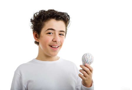 rapid prototyping: Happy Hispanic boy in white long sleeved t-shirt smiles holding 3D printed lightbulb with left hand