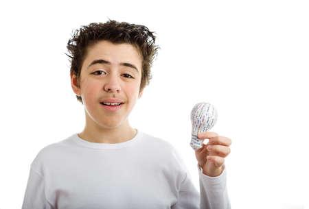 long sleeved: Happy Hispanic boy in white long sleeved t-shirt smiles holding 3D printed lightbulb with left hand