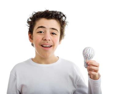 sleeved: Happy Hispanic boy in white long sleeved t-shirt smiles holding 3D printed lightbulb with left hand