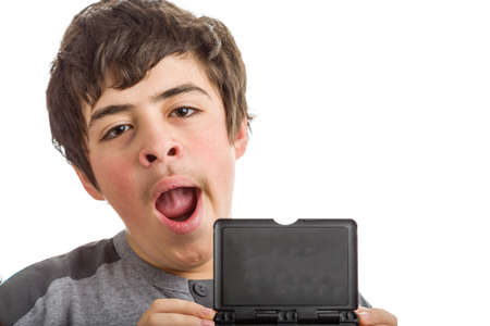 gape: Tired Caucasian boy wearing a grey sweatshirt  yawns holding a  blank black plastic sign