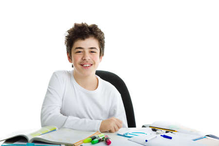 elbow white sleeve: Calm and confident Caucasian boy wearing a white long sleeve t-shirt smiles while his right elbow is resting on homework
