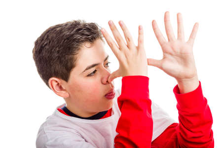 sleeved: A Hispanic child wearing red long sleeved shirt thumbs his nose from left to right with both hands showing profile