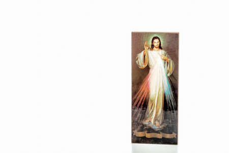 Isolated on white background, an icon with the picture of the Merciful Jesus without writings on the ribbon where you can write your language version of Jesus, I trust in you 스톡 콘텐츠