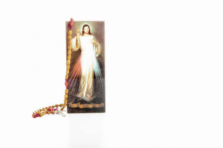 the merciful: Light Brown Rosary beads and a picture of the Merciful Jesus with blank ribbon without writing at the bottom