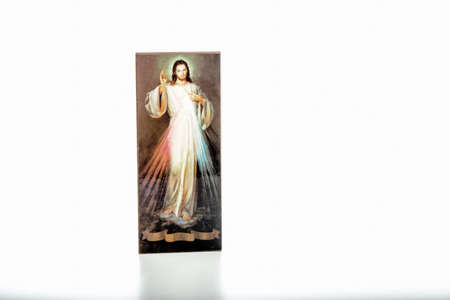 Isolated on white background, an icon with the picture of the Merciful Jesus without writings on the ribbon where you can write your language version of Jesus, I trust in you Stock Photo