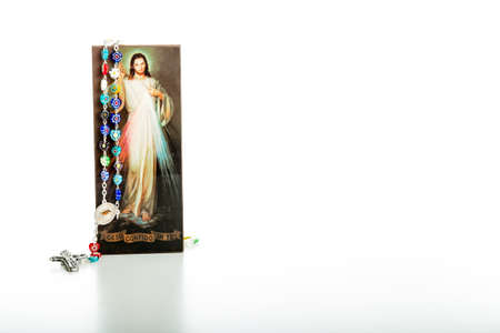 the merciful: Rosary glass beads and a picture of the Merciful Jesus Stock Photo