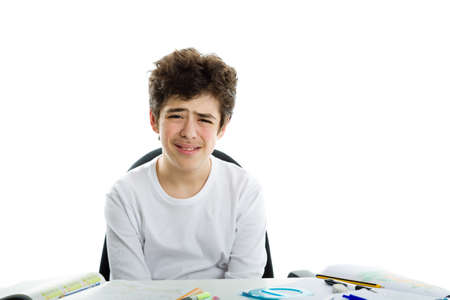 long sleeve: Cute Latin boy sadly sitting in front of homework wearing a white long sleeve t-shirt Stock Photo
