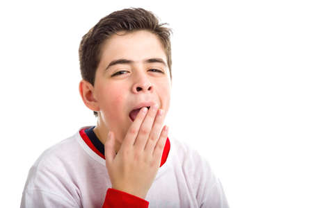 gape: A Soft skinned Latin boy yawning cover his mouth with right hand wearing white t-shirt on a red one with longer sleeves