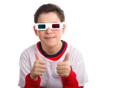 soft skin: A caucasian boy with soft skin wears a pair of white 3D Cinema googles with red and sky-blue lenses making success sign with both thumbs up