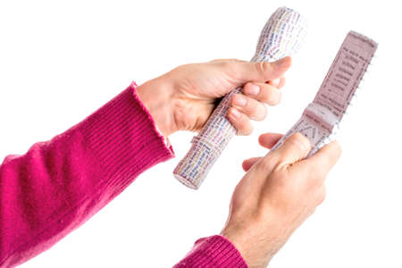 prototypes: Caucasian smooth-skinned  adult hands in red sweater holding 3D Print labelled prototypes of white flashlight and clam shell mobile phone