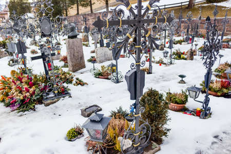 Snowy Catholic cemetery on high mountains photo
