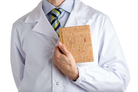 white coat: Man dressed with medical white coat, light blue shirt and glossy regimental tie with dark blue, light blue and green stripes, is holding a blank cork book