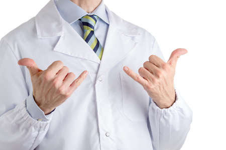 Man dressed with medical white coat, light blue shirt and glossy regimental tie with dark blue, light blue and green stripes, is making  Hawaiian shaka or hang loose gesture with both hands meaning thanks, all right, hello,  approval or praise