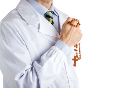 white coat: bust of a man wearing medical white coat, blue shirt and glossy regimental tie and holding wooden Rosary beads with right hand