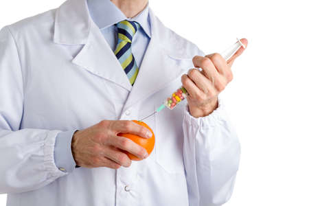 white coat: bust of a man wearing medical white coat, light blue shirt and glossy regimental tie white dark blue, light blue and green stripes, and makes an injection to orange