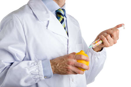 white coat: bust of a man wearing medical white coat, light blue shirt and glossy regimental tie white dark blue, light blue and green stripes, and makes an injection to yellow lemon